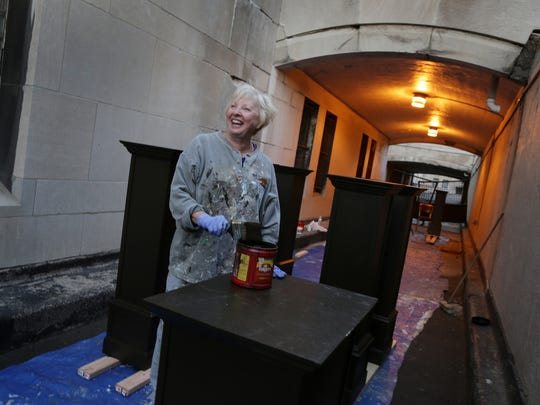 Ginny Dunivant, mother of Artist John Dunivant who is the mastermind behind Theatre Bizarre helps paint props at the Masonic Temple in Detroit on Sunday, October 11, 2015.