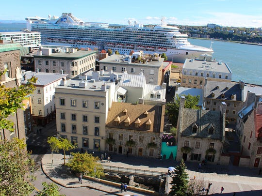 A cruise ship docked in the lower town of old Quebec