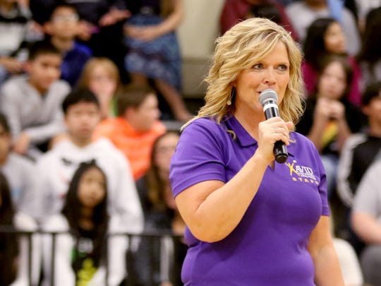 Barb Bamford, an AVID coordinator, speaks during an assembly announcing the start of an effort to earn the status of an AVID National Demonstration School at Stephens Middle School in Salem on Wednesday, Oct. 14, 2015.