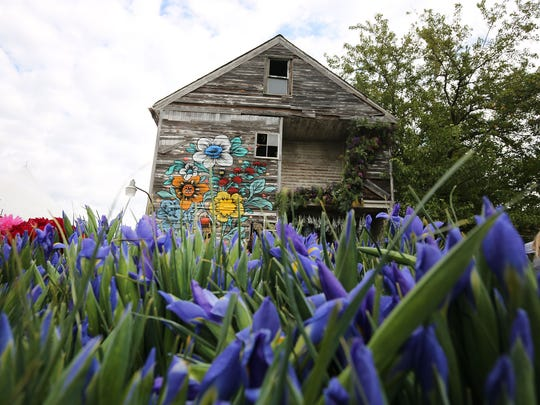 The abandoned home at 11751 Dequindre in Hamtramck filled with more than 30,000 flowers.