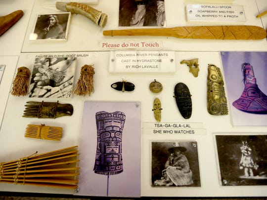 Native American artifact replicas are on display at the Traveling Museum of Oregon Prehistory at Champoeg State Park in St. Paul, Ore., on Saturday, Oct. 17, 2015.