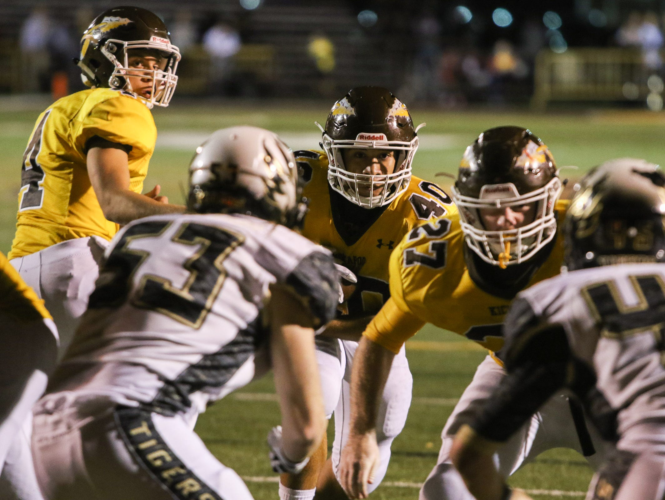 Kickapoo High School running back Malachi Stout looks to the end zone in the second half against Lee's Summit High School Friday, October 23, 2015. Jason Connel / For the News-Leader
