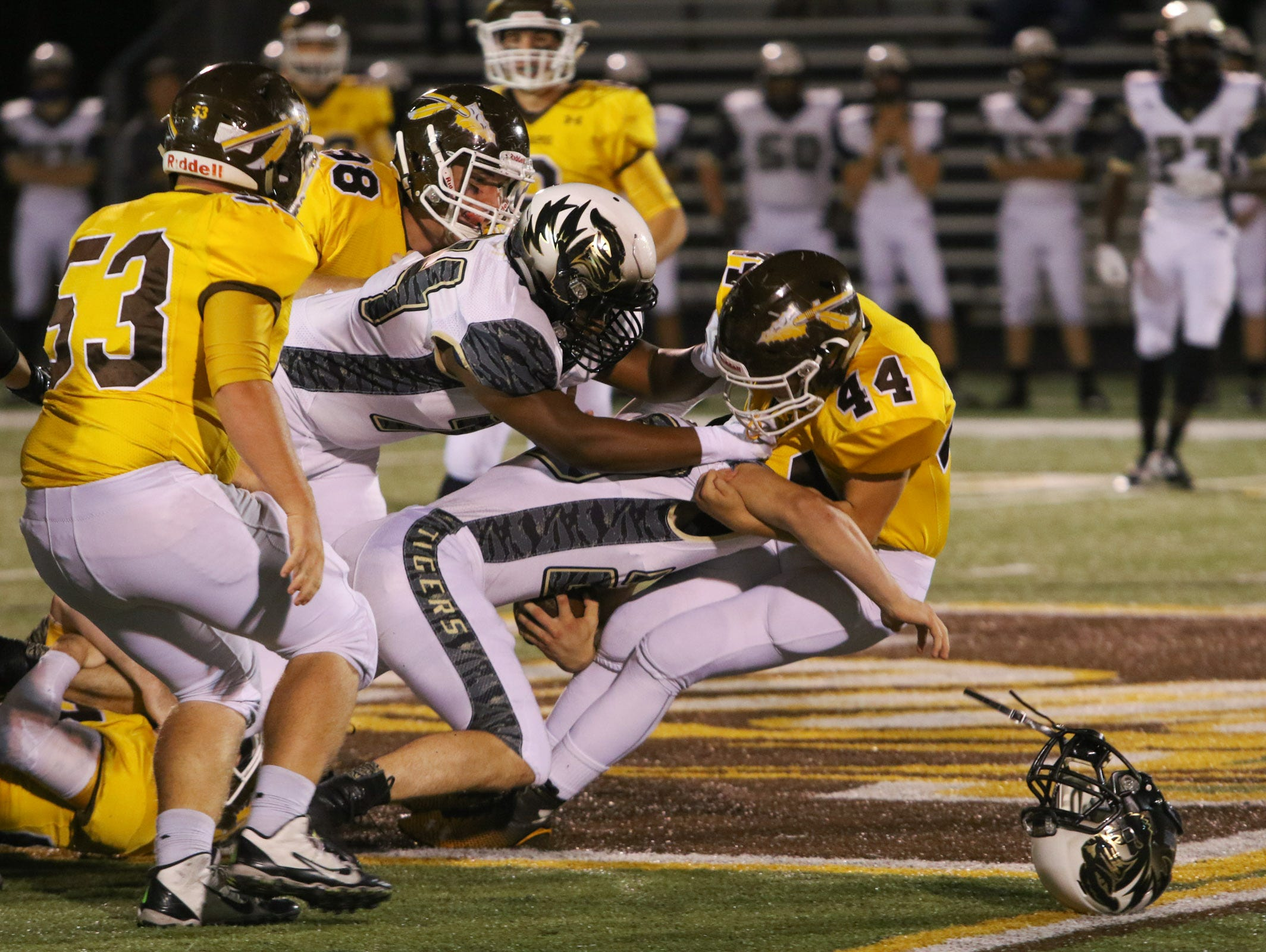 Kickapoo High School linebacker Tre Woodring forces down Lee's Summit High School's offense Friday, October 23, 2015. Jason Connel / For the News-Leader