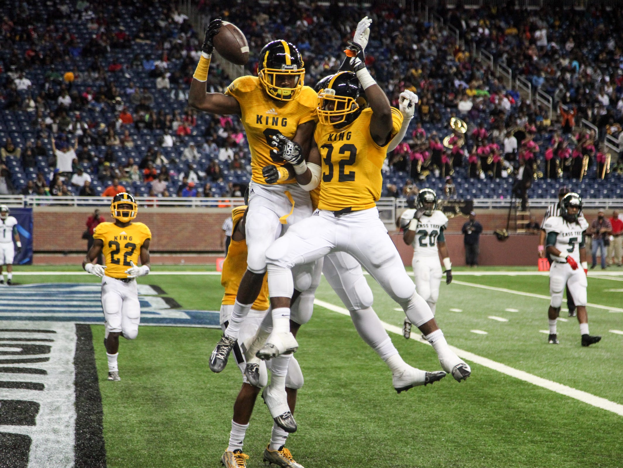 M.L. King Crusaders Donnie Croley (9) celebtrates with Martell Pettaway (32) after scoring a touchdown, during Division I Detroit Public School League 2015 Football Championships at Ford Field In Detroit, on Friday, Oct. 23, 2015.