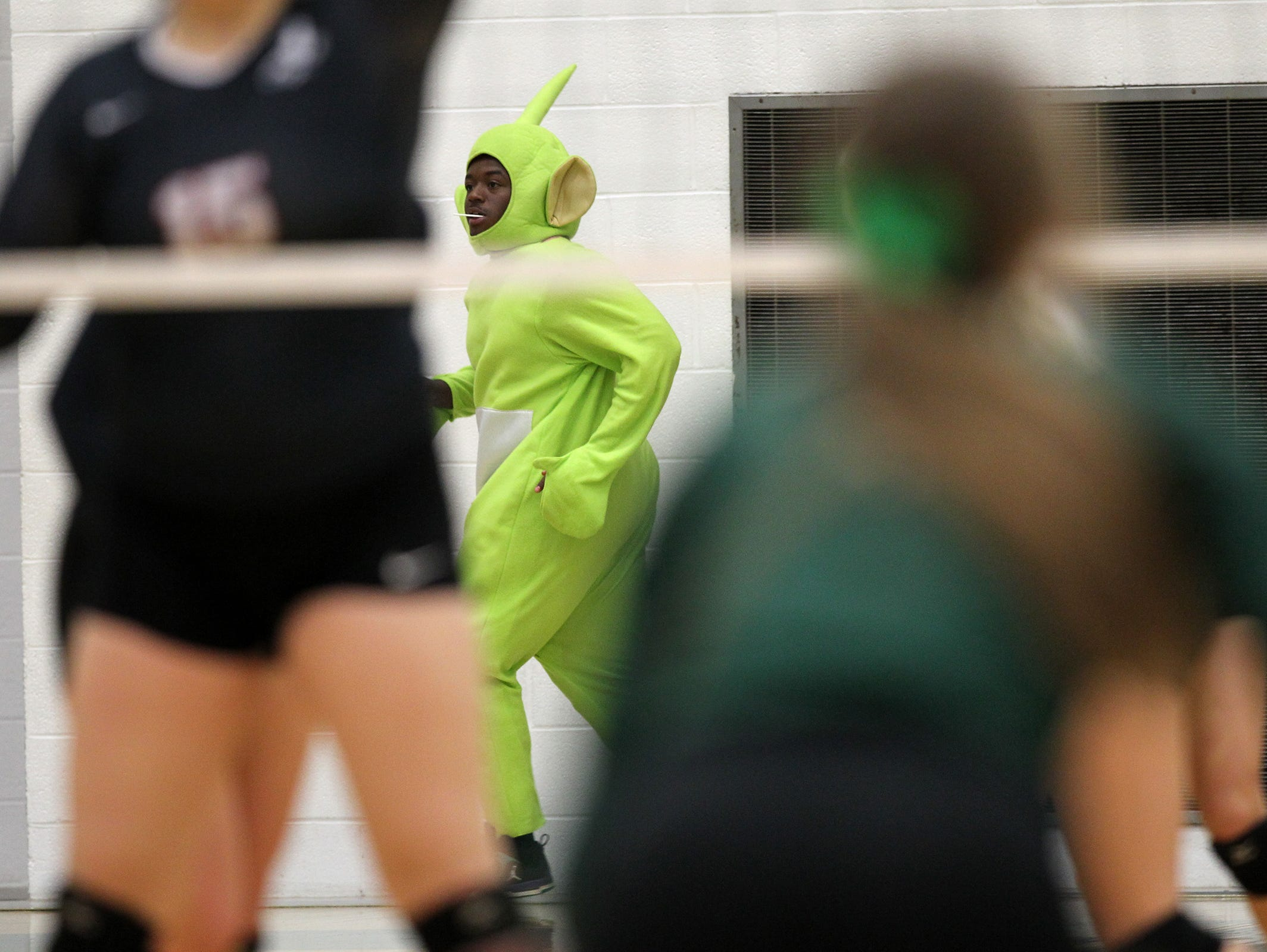 West High junior Khalloe Jordan runs back to the bleachers during the Women of Troy's regional semifinal game against City High at West High on Thursday, Oct. 29, 2015.