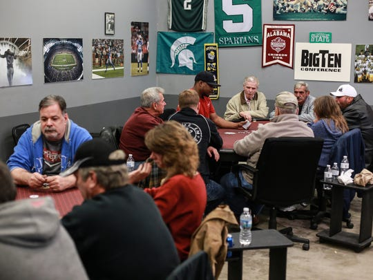 People play a game of Texas Hold'em at Legends Poker Place in Metamora on Thursday, Oct. 29, 2015, while playing for charity benefiting the Lapeer Chamber of Commerce.