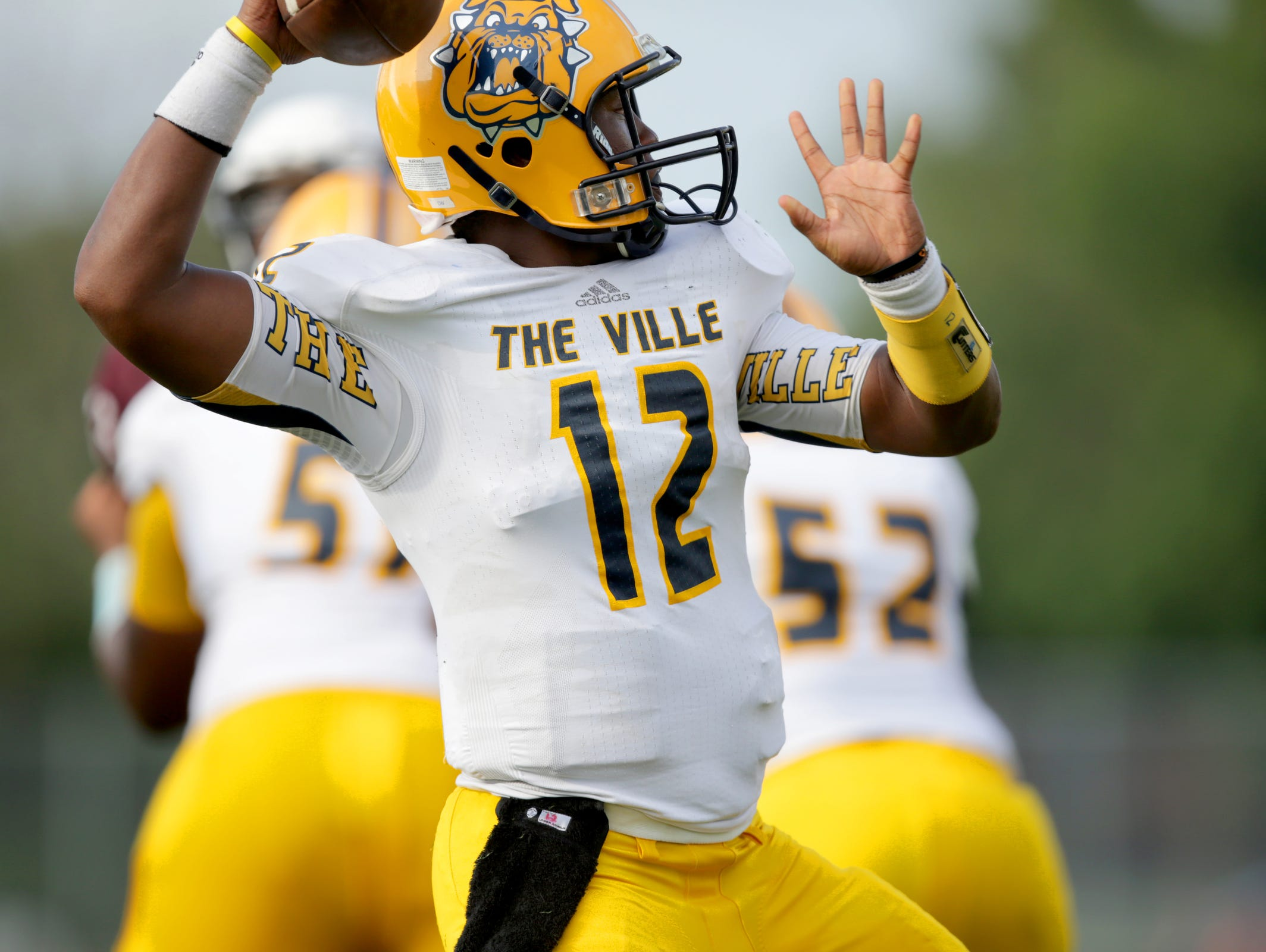 East English Village Prepatory Academy QB Delvin Washington (12) throws the ball during Detroit Public School League football game against Renaissance Varsity football team at Renaissance High School in Detroit on Friday, Sept. 4, 2015.