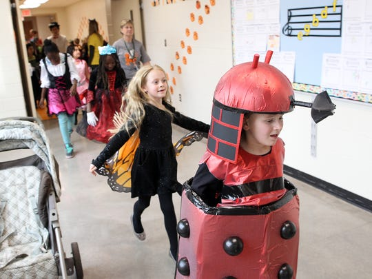 Twain Elementary students parade through the halls in their Halloween costumes on Friday, Oct. 30, 2015.