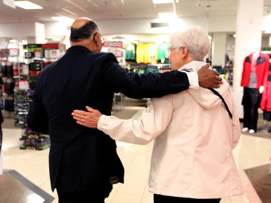 Joseph Daniel says goodbye to customer Sue Fletcher, of Dallas, at the JCPenney in downtown Salem on Friday, Oct. 30, 2015. Daniel is retiring after 38 years with the company.