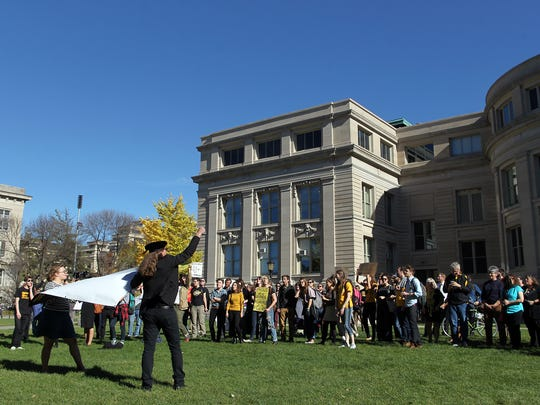 Protesters gather on the Pentacrest lawn outside Jessup