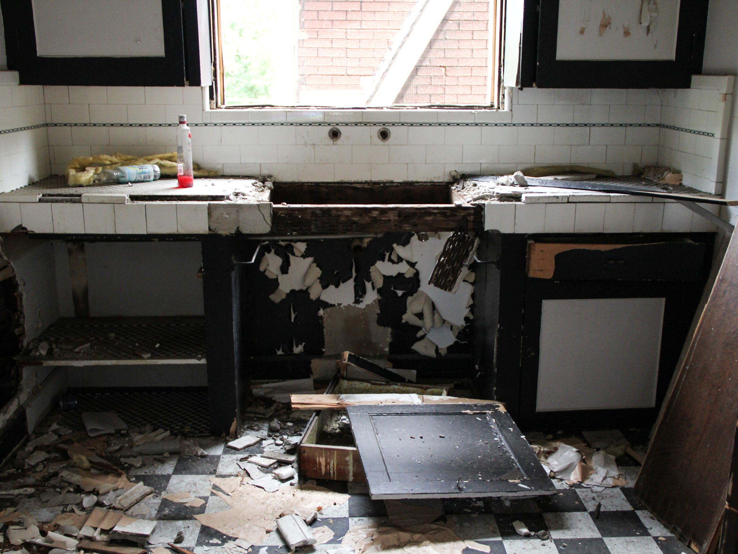 Scavengers destroyed the kitchen in the second-floor apartment at 7124 Tuxedo in Detroit after the home was abandoned in 2012. They took the fixtures and pipes and some tiles.