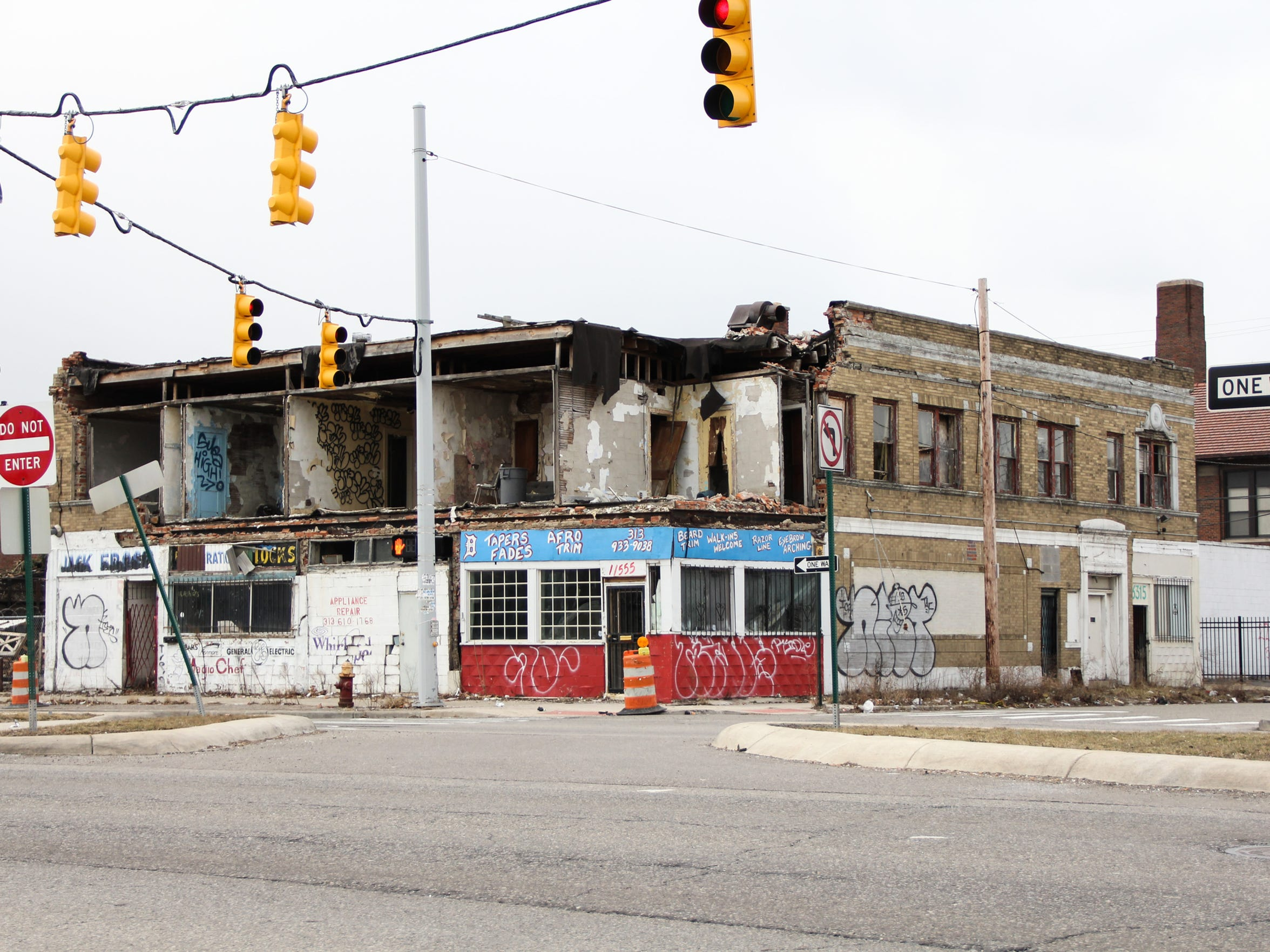A commercial stretch of Livernois near Grand River in Detroit, in late summer of 2012. This building has since been demolished. Once a thriving center of small business, the area has struggled as population and investment have dwindled.
