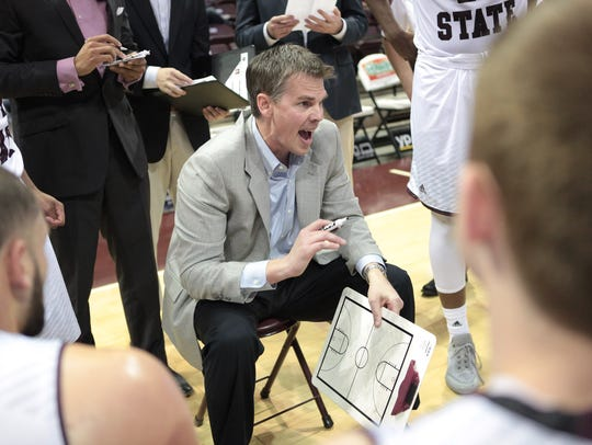 Missouri State University coach Paul Lusk speaks with