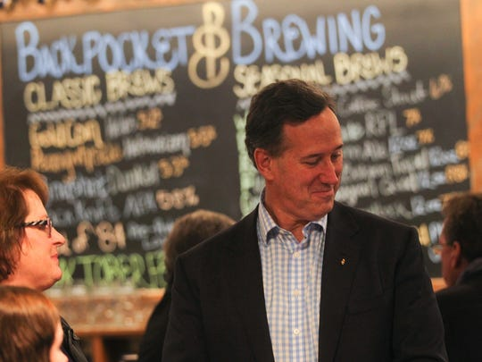 Republican presidential candidate Rick Santorum chats with patrons at Backpocket Brewing in Coralville on Wednesday, Nov. 18, 2015.