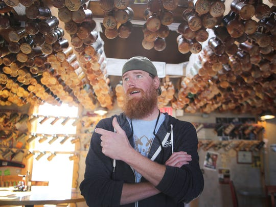 """Bryan """"Wiggs"""" Wiggs , the  brewery operations manager, for Dark Horse Brewing, Co., a local brewery founded by in Marshall, Mich. stands in the Taphouse Monday, Nov. 2, 2015."""