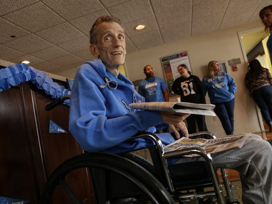 Detroit Lions fan Chris Liwak sits in the lobby on Tuesday, Nov. 24, 2015, at Heartland Livonia North East. Liwak is dying of lung cancer in hospice and had a last wish to attend a Lions game.
