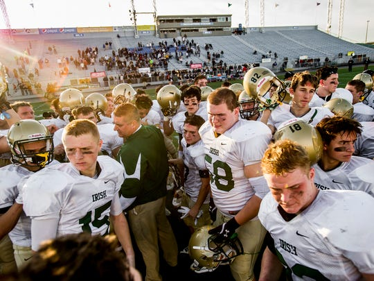 York Catholic players break their final huddle of the season after a postgame speech by coach Eric Depew following a 40-28 loss to Camp Hill in the District 3 Class A championship game at Hersheypark Stadium on Friday, Nov. 27, 2015.