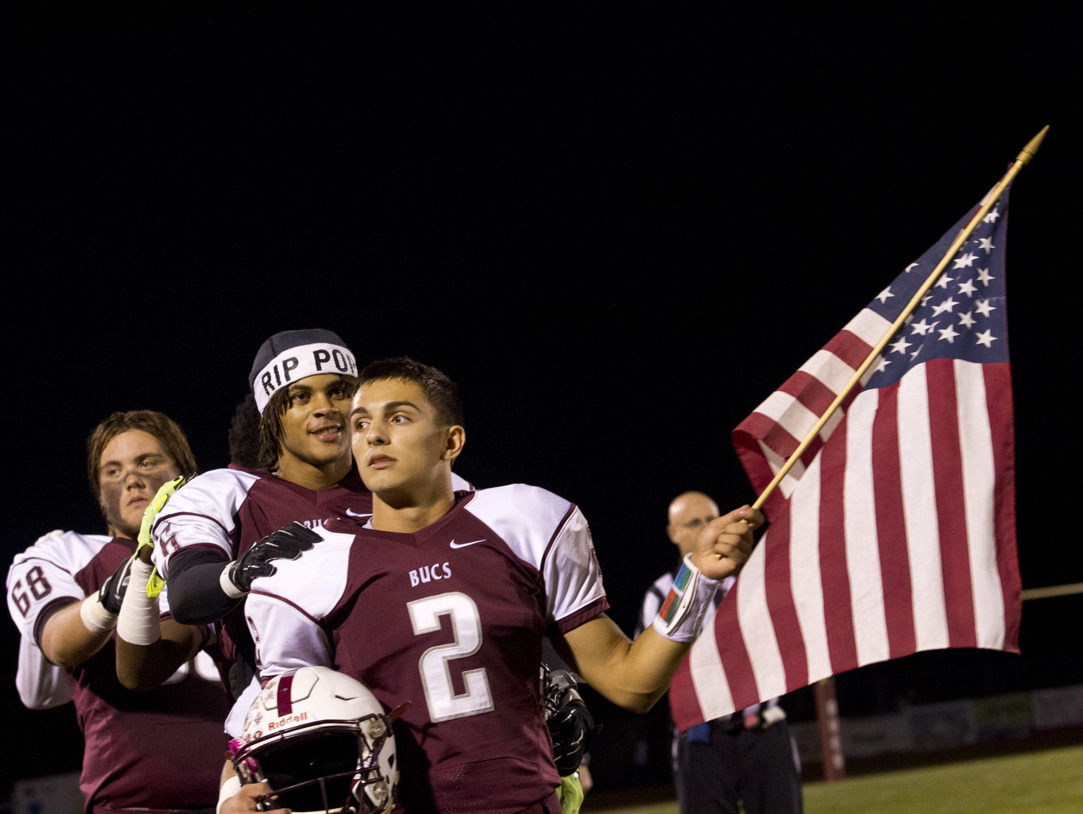 Red Bank Regional quarterback Jack Navitsky holds a flag as the National Anthem plays prior to game against Red Bank Catholic. Red Bank Catholic vs Red Bank Regional Football on October 16, 2015 in Red Bank.