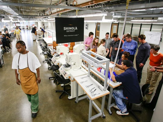 Guests toured Shinola's Detroit factory during a ceremonial ribbon cutting in 2014 at the A. Alfred Taubman Center for Design - College for Creative Studies.