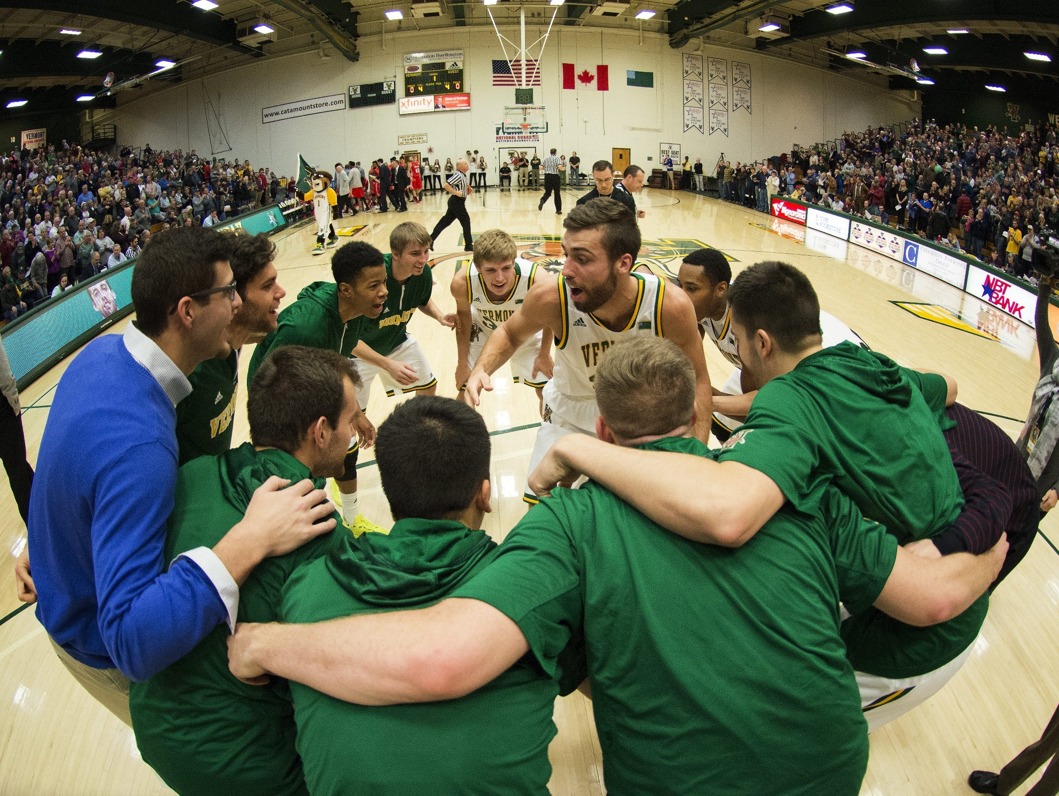 The Catamounts huddle together before the start of the men's basketball game between the Marist Red Foxes and the Vermont Catamounts at Patrick Gym on Sunday afternoon in Burlington.