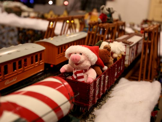 The Santa Express, a model train, goes around the tracks during Magic at the Mill.