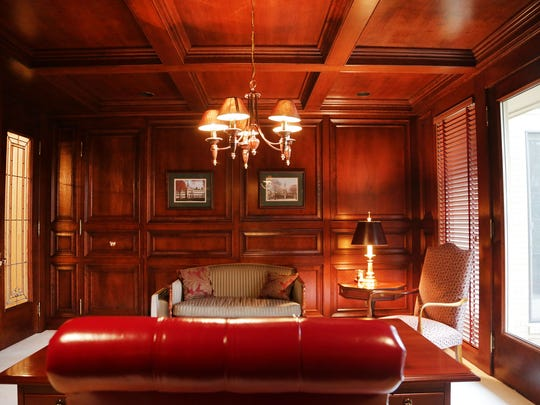 The wood paneled office.
