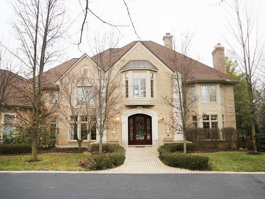 This Colonial home is located within the gated community of Heron Bay in Bloomfield Township.