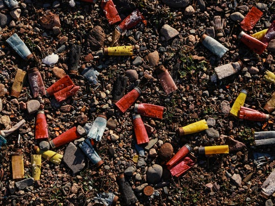 Shotgun shells line the ground from previous shooting in a field during training for the War Club in a field outside of Marquette on Saturday November 14, 2015 in Michigan's Upper Peninsula.