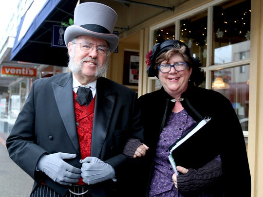 Dan Bailly and Trudy McKinnell visited Holding Court in Victorian period costume to promote the Festival Chorale Oregon concert on Sunday.