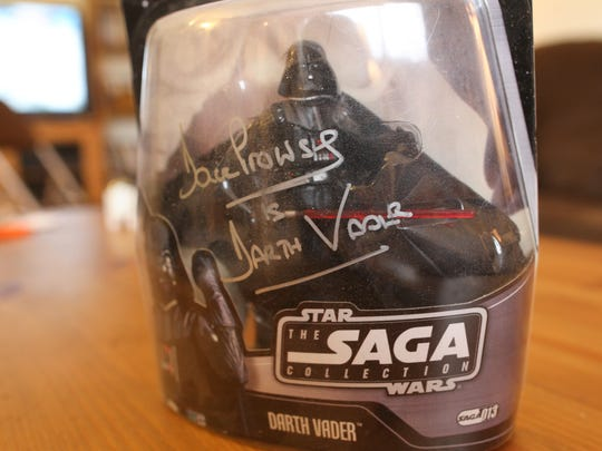 A Darth Vader figure, signed by David Prowse, is seen at Brian Kleis' home on Tuesday, Dec. 15, 2015. The long-time Star Wars fan received the prosthetic leg in April after an infection spread and required part of Kleis' leg to be amputated.