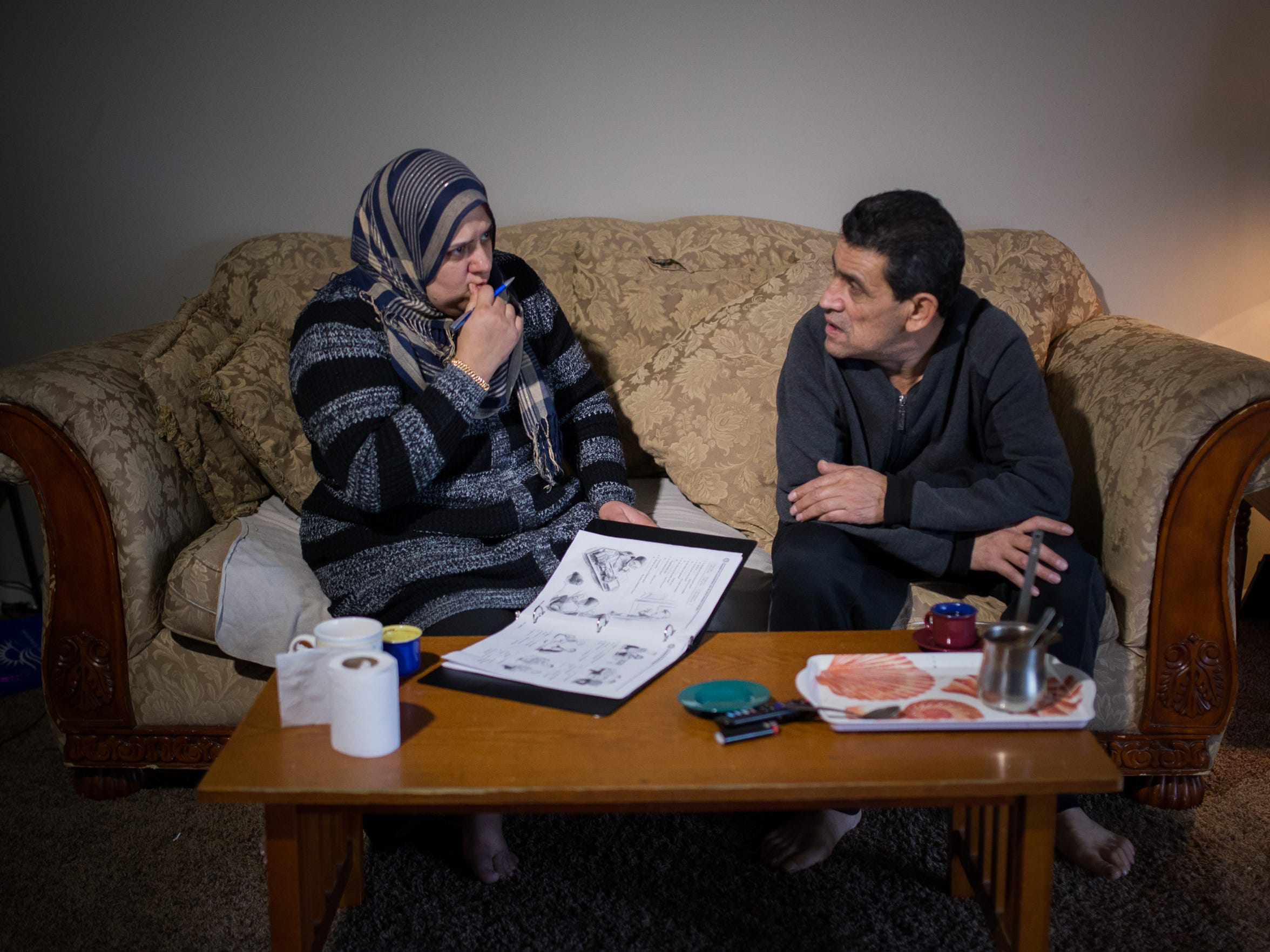 Radwan Mughrbel, 52, and his wife Sanaa Hamada, 42, refugees from  Syria, work on homework in their Bloomfield Hills apartment before their evening English as a Second Language class (ESL), on Wednesday, Nov. 18, 2015.