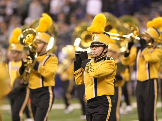 The Hawkeye Marching Band performs prior to Iowa's Big Ten championship game against Michigan State at Lucas Oil Stadium in Indianapolis, Ind., on Saturday, Dec. 5, 2015. The band is prepping for its performance at the Rose Bowl.
