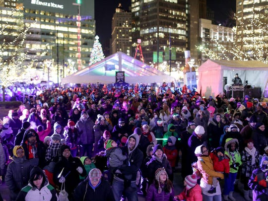 A large crowd of families gathers before counting down the Kids' Drop at Cadillac Square as part of the 5th Annual Motor City New Year's Eve-The Drop celebration at Campus Martius and Cadillac Square in downtown Detroit on Dec. 31, 2014.