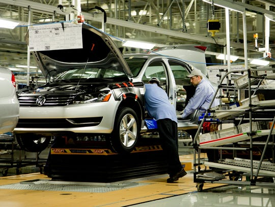 Workers assemble a Volkswagen Passat at the German