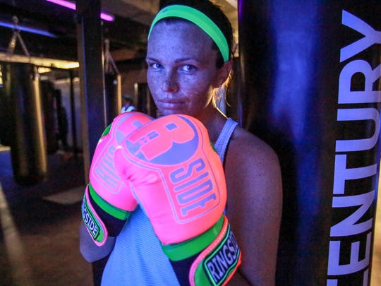 Courtney Handren, 23, of Royal Oak participates in the kickboxing class at Jabs Gym in Eastern Market, Detroit on Thursday, Dec. 17, 2015. Handren has been training with Instructor Ice at the Birmingham location and says she fell in love with the view of they city and the atmosphere of the new gym space.