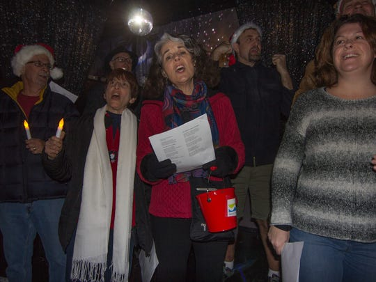It was a very cold night, but the happy carolers who came out to raise money for the Well in the Desert were not deterred. We must have walked miles, but we walked those miles with glee, singing to Village Fest guests, restaurant patrons, bar patrons and all who would listen. We were from 16 months old to 80 years old, from all walks of life. It was a night of joy and pleasure and looking at the faces of those who participated confirms that. Next year we hope you will join us.
