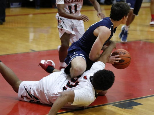 West York's Nick Sarver, top, tries to keep the ball away from J.P. McCaskey's Skyler Davis  during Monday's holiday tournament in Lancaster.