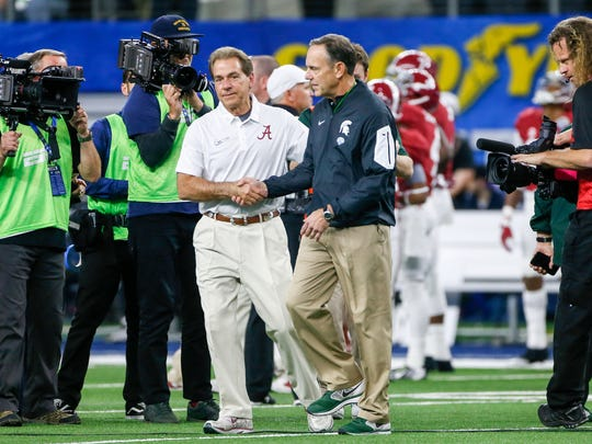 Nick Saban shakes hands with Mark Dantonio before the Cotton Bowl Classic in Arlington, Texas on Dec. 31, 2015.