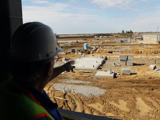 Duane Van Hemert points out areas in the front portion of Liberty High School on Thursday, Oct. 22, 2015. This side of the school will include the athletic fields, auditorium and other space for other extra curricular activities.