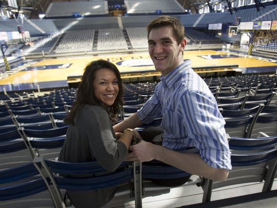 FILE – Andrew Smith, Butler center, and his wife to be Samantha Stage, in Hinkle Fieldhouse, Feb. 19, 2013.
