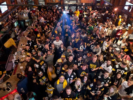 Inside the Carson City Saloon on Pittsburgh's South Side, it's a sea of black and gold.
