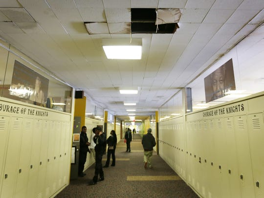 Water damage from a now fixed leaky roof  in a hallway at Osborn Collegiate Academy of Mathematics Science and Technology in Detroit on Thursday, Jan. 14, 2016.