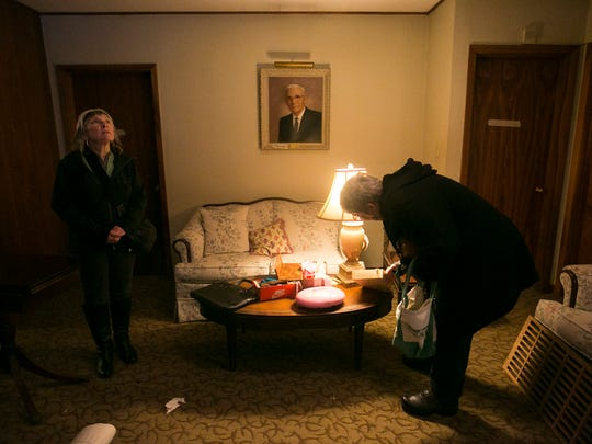 Judy Mahr, left, and Sharon Henegar, right, look through items in the Barrick Funeral Home closing sale on Saturday, Jan. 16, 2016. Henegar writes Queen of Fifty Cents, a blog about thrift shopping and yard sales, and the two came to the sale to look at the historic building and check out any antiques offered. A photo of Dr. L.E. Barrick, the first Barrick to own the funeral home, hangs on the wall.