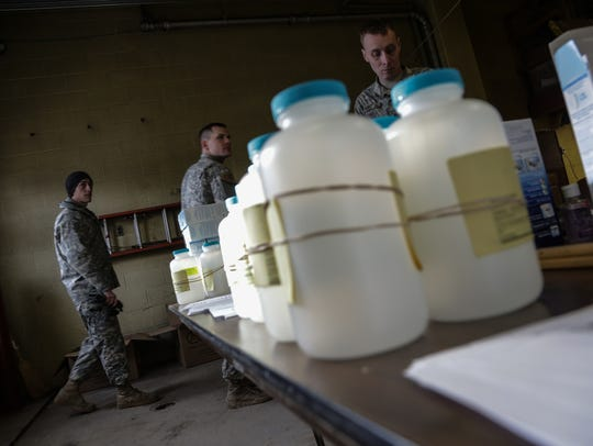 Water analysis test kits sit for Flint, Mich., residents