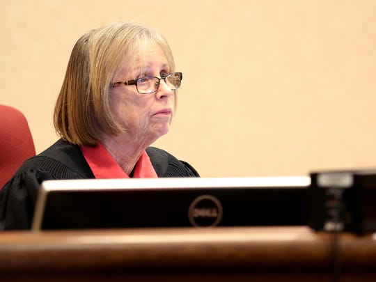 Judge Sally Avera listens to recommendations from the state and the defense during the sentencing hearing for Andrew Brunkal at the Polk County Circuit Court in Dallas, Ore., on Wednesday, Jan. 20, 2016. Brunkal was found guilty on 26 counts related to sex abuse and was sentenced to more than 16 years in prison.