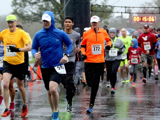 Racers start the 17th annual Cascade Half Marathon, 10K and 2-mile at Cascade Junior High School in Turner, Ore., on Sunday, Jan. 17, 2016.