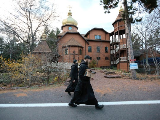 Father Ephrem and Father Ambrose walk back to the Holy Transfiguration Skete monastery in Eagle Harbor after working all day in the Jampot before evening prayer.
