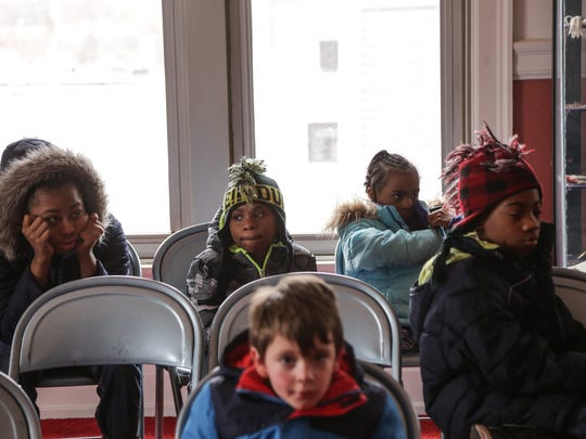Children wait to have blood samples taken to be tested for lead on Saturday,Jan. 23, 2016, at the Masonic Temple in downtown Flint.
