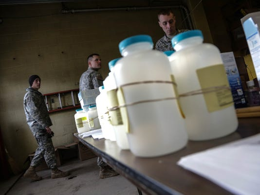 635891751163203490-011816-flint-water-samples-.jpg