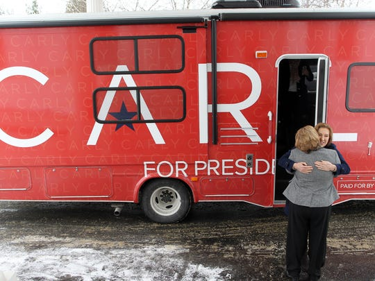 Carly Fiorina steps out of her campaign bus and is greeted by a large hug from Cathy Grawe, a member of the Johnson County Republicans, prior to her town hall meeting at the University Club in Iowa City at 11:05 a.m. Tuesday, Jan. 26, 2016.